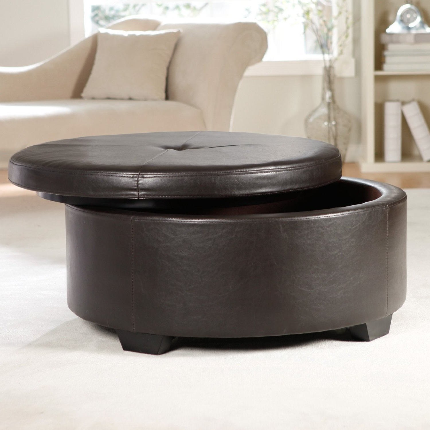 - Black Round Ottoman Royals Courage : Black Leather Ottoman In